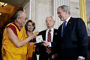The Dalai Lama receiving a Congressional Gold Medal in 2007. From left: Nancy Pelosi, Robert Byrd and George W. Bush