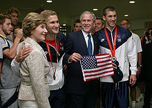 Bushes with Michael Phelps and Larsen Jensen.jpg