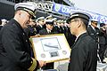 CO of USS Blue Ridge presents a gift to a Japanese officer. (8570977087).jpg