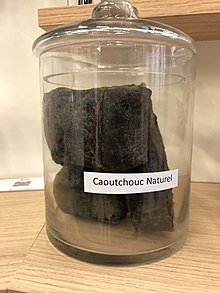 Photo of pieces of natural rubber in a glass jar.