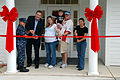 Capt. Bette Bolivar, left, commanding officer of Naval Weapons Station Yorktown and Jim Brady, Vice President of Lincoln Military Housing, get help cutting a ribbon during the grand opening of the new from 090506-N-PK884-001.jpg