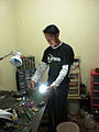 Carlos From Xela Teco Working on Solar Lights.jpg