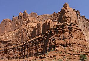 Entrada Sandstone -  Entrada Sandstone conformably overlies Carmel Formation, Park Avenue, Arches National Park
