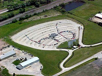 """Litchfield, Illinois - Cars in a """"66"""" formation at the SkyView Drive-In."""