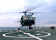 Chetak Helicopter from the INS Rana (D 52) prepares to land onto the flight deck of USS Stethem (DDG 63)
