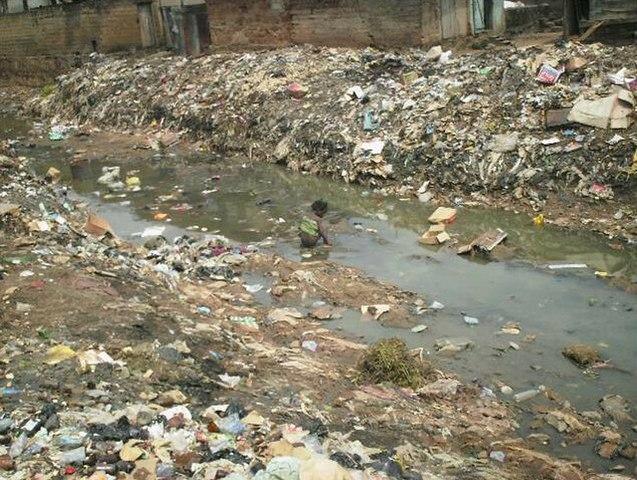 Child in open sewer in Nigeria (3150664698)
