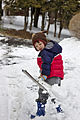 Child using a snow shovel to remove snow 04.jpg