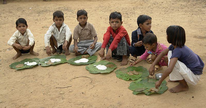 Children eating kheer and puri, Chambal, India.jpg