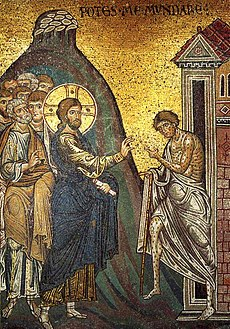 Jesus, his head surrounded by a halo, puts his hands on a leper, thereby healing him