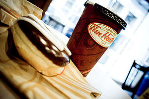 A coffee and doughnut at a Tim Hortons outlet ...