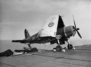 Corsair on outrigger aboard HMS Khedive (D62) 1945.jpg
