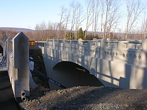 Lackawanna Cut-Off Restoration Project - Preservation efforts during the 1980s led to a newly configured crossing of the Cut-Off on County Route 521 in Blairstown.  Shown here in November 2006, the new bridge is a replica of its older companion to the left, which kept the right-of-way intact below.