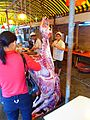 Cow carcase hanging in Haikou restaurant - 01.JPG