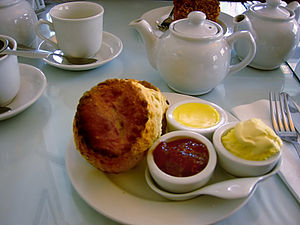 Scones with butter, jam and clotted cream.