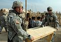 DVIDS13582 - U.S. soldiers deliver desks and school supplies to local An Nasiriyah children.jpg