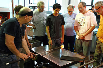 Corning Museum of Glass - Master artist Davide Salvadore (left) teaches technique during a class