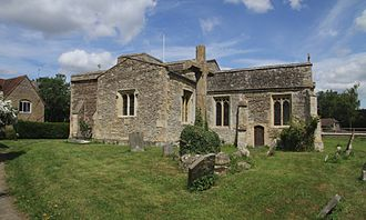 Denchworth - St James' parish church from the southeast, showing the chancel, south transept and churchyard cross