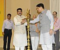 """Dharmendra Pradhan lighting the lamp to inaugurate the National Conference on """"Energy Security for India-Creating a Biofuel Economy"""", on the occasion of the World Biofuel Day, in New Delhi.jpg"""