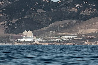 Diablo Canyon Power Plant - Diablo Canyon Power Plant, 2009 photo from offshore. The light beige domes are the containment structures for Unit 1 and 2 reactors. The brown building is the turbine building where electricity is generated and sent to the grid. In the foreground is the Administration Building (black and white stripes).