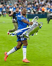 Didier Drogba Holding The Champions League Trophy After Chelseas Victory In 2012