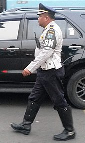 cd79e94cb0cd6a An Indonesian Traffic Warden wearing a peaked cap