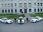 Dodge County Sheriff's Office (Nebraska) deputies, with vehicles.jpg