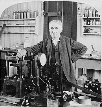 Thomas Edison was an American inventor, scientist, and businessman who developed many devices that greatly influenced life around the world, including the phonograph, the motion picture camera, and a long-lasting, practical electric light bulb. Edison in his NJ laboratory 1901.jpg