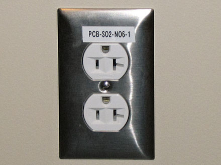 5-20RA (Canada) or 5-20R (US) T-slot socket mounted with the earth hole up. The neutral connection is the wider T-shaped slot on the right. Electrical outlet with label.jpg