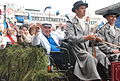 Eri Klas and other musicians riding in a parade to the XXV Estonian Song Celebration.jpg