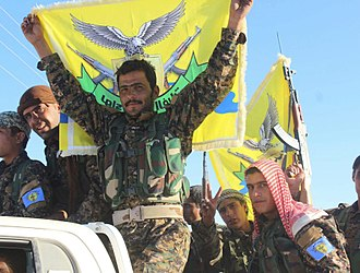 Syrian Democratic Forces military councils - Fighters of the Euphrates Liberation Brigade, part of the Manbij Military Council, in Manbij