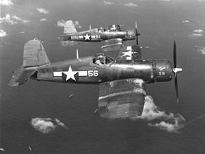 VMF-113 - Two F4U-1A Corsairs of VMF-113 over Eniwetok Atoll, in July 1944.