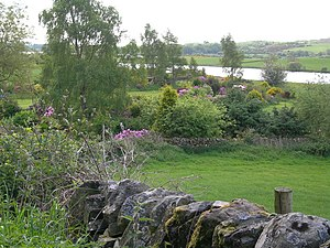 English: Farmland, cottage gardens & Loch Ken