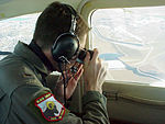 First Lt. Chad Morris of the Civil Air Patrol's Colorado wing photographs a sports utility vehicle.jpg
