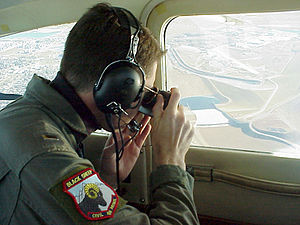 Colorado Wing Civil Air Patrol - First Lt. Chad Morris of the Civil Air Patrol's Colorado wing photographs a sports utility vehicle from 1,000 feet during a homeland security mission simulation.