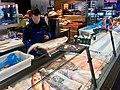 Fiskebryggen, Mathallen, Fishmarket, Bergen, Norway 2018-03-16. Cod fish, etc for sale at seafood dispaly counter at Fjellskål Fisk & Skalldyr store and restaurant.jpg