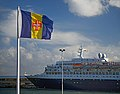 Flag of Madeira and Saga Sapphire in the port of Funchal. Madeira, Portugal.jpg