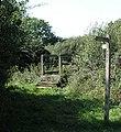 Footbridge and fingerpost on footpath 1781 - geograph.org.uk - 244885.jpg