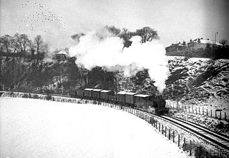 Balerno line - A freight train hauled by locomotive 47163 approaches Juniper Green from Colinton