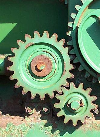 Gear train - 2 gears and an idler gear on a piece of farm equipment, with a ratio of 42/13 = 3.23:1