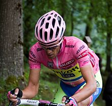 Alberto Contador riding uphill while wearing the pink jersey