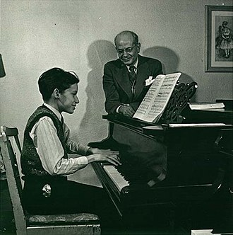 Glenn Gould - Glenn Gould with his teacher, Alberto Guerrero, demonstrating Guerrero's technical idea that Gould should pull down at keys instead of striking them from above. The photo was taken in 1945, before Gould fully developed this technique.