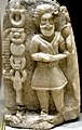 God stabbing a snake before a staff and a flag. From Hatyra, Iraq. 2nd to 3rd century CE. Iraq Museum.jpg
