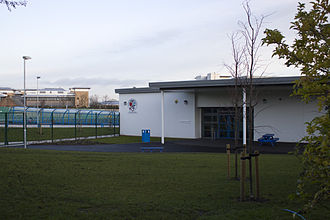 Gosforth Junior High Academy - The Key Stage 2 entrance of the 2011 buildings of Gosforth Junior High Academy. A section of the 1930s buildings can still be seen in the middle-right. The Virgin Money banking headquarters can be seen in the background.