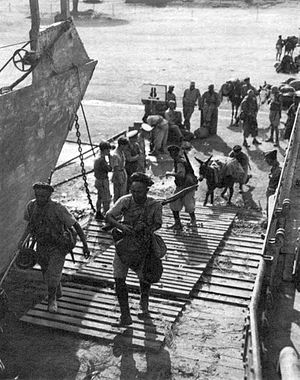 Moroccan Goumier - Goumiers of the 2nd Group of Moroccan Tabors embarking on a Landing craft in Corsica, destination Elba.
