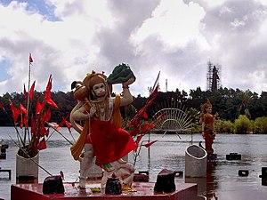 Religion in Mauritius - Hanuman, Ganga and Shiva statue under construction in the background at Ganga Talao