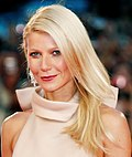 Gwyneth Paltrow—a white female with blue eyes and straight, shoulder-length blonde hair, wearing a cream-colored, high-collared dress—attending the 2011 Venice Film Festival at age 38.