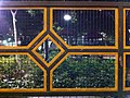 HK Tai Kok Tsui night Anchor Street Playground steel fence pattern Dec-2012.JPG