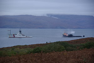HMS Astute (S119) - Astute aground with  the emergency tow vessel Anglian Prince