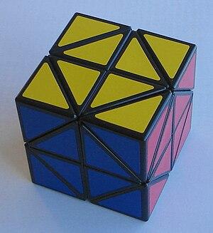 Katsuhiko Okamoto - The Bevel/Helicopter Cube, developed by Okamoto and Adam Cowan independently.