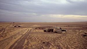 Trans-Sahara Highway - Tracks and abandoned vehicles near the border to Niger